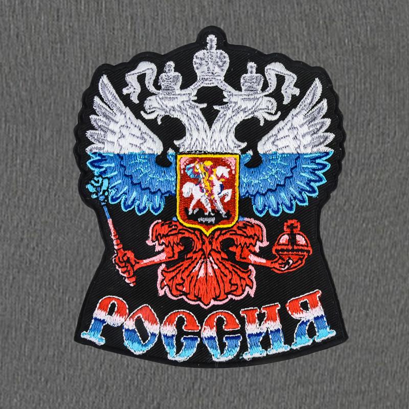 Фирменные спортивные штаны с Российским гербом.