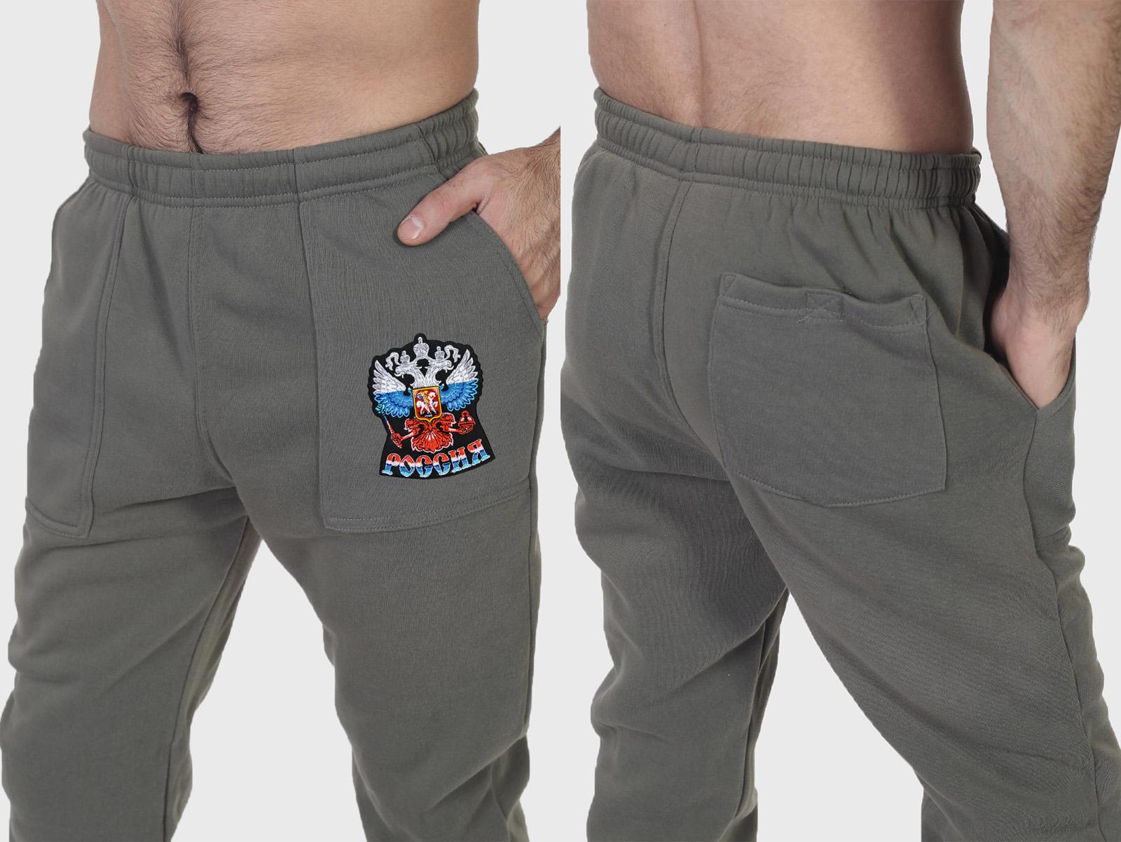 Фирменные спортивные штаны с Российским гербом заказать в Военпро